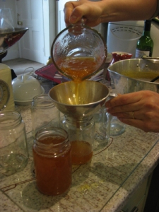 Pouring the cooled marmalade into jars